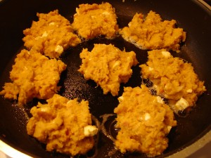 Vegetarian spiced kumara and feta patties frying - Photo Theresa Sjoquist