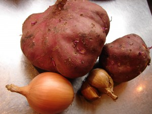 Kumara with onions and garlic - ingredients for Kumara patties - photo Theresa Sjoquist