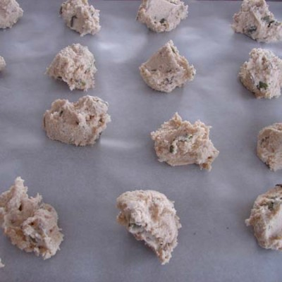 Sugar-free Gluten-free Vanilla-Cardamom Almond biscuit mixture dropped onto tray ready for flattening